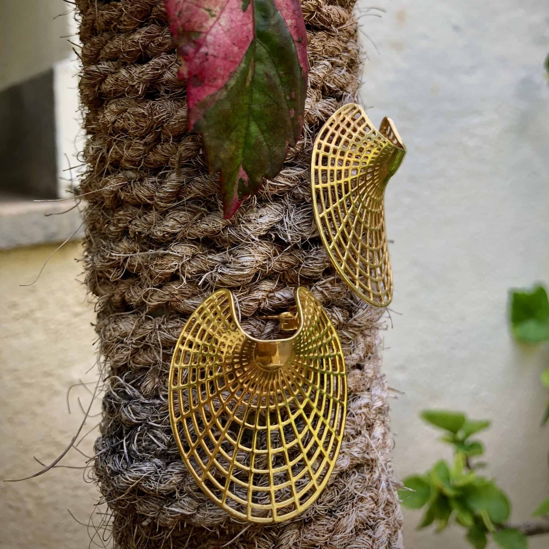 Image showing ribelli's gold plated sterling silver earrings with a unique shape and design. the earring has a checkered filigree work making it light.